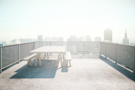 balcony view: Balcony design with table and benches, concrete floor and railing on sunlit city background. 3D Rendering