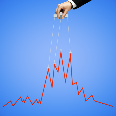 manipulating: Businessman hand manipulating graph on blue background
