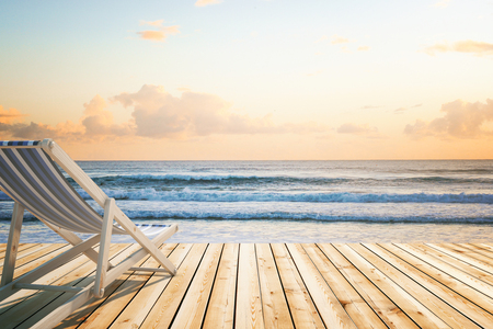 chaise longue: Chaise longue on wooden floor at the seaside. 3D Rendering Stock Photo