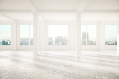 Spacious interior with concrete floor, columns and windows. 3D Rendering Stock Photo