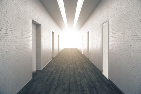 numerous: Corridor interior with dark wooden floor, brick walls, numerous doors and light at the end. 3D Rendering Stock Photo
