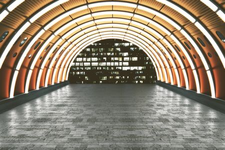 tunnel view: Illuminated orange tunnel with brick tile floor and building view. 3D Rendering Stock Photo