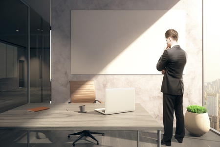 modern office: Thoughtful businessman in office with blank whiteboard. Mock up, 3D Rendering Stock Photo