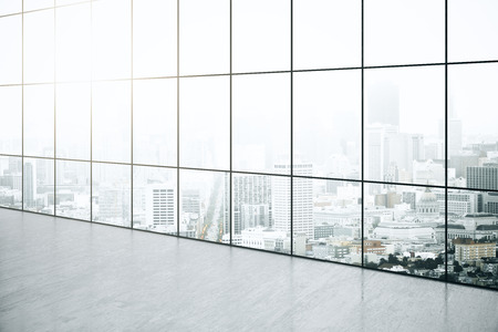 panoramic windows: Empty interior with concrete floor and panoramic windows with city view. 3D Rendering