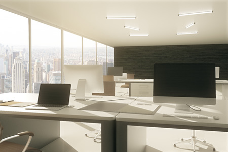 laptop screen: Grey office workspace with blank laptop and computer screen. 3D Rendering