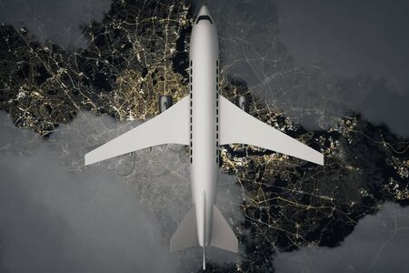 travelling: Top view of airplane and clouds above night landscape. 3D Rendering Stock Photo