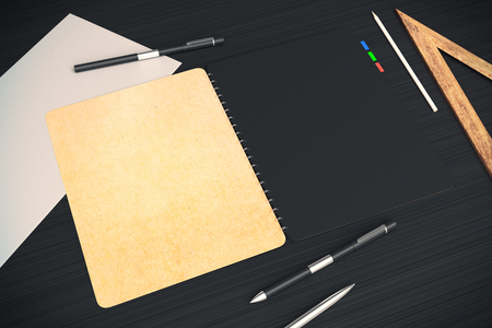 dark beige: Closeup of open notepad with black and beige pages placed on dark desktop with other office tools. Mock up, 3D Rendering