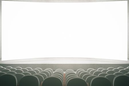 screen: Movie theater with rows of grey seats and large blank screen. Mock up, 3D Rendering Stock Photo