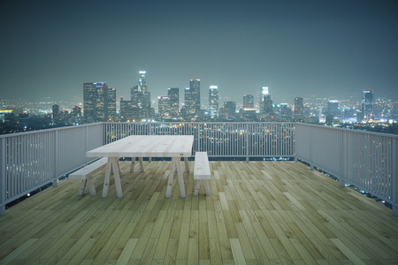 condo: Balcony design with table and benches, wooden floor and railing on illuminated night city background. 3D Rendering