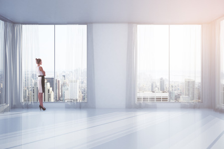 window view: Businesswoman standing in empty interior with curtains and windows with New York city view. 3D Rendering
