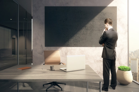 staring: Thoughtful businessman in office with blank chalkboard. Mock up, 3D Rendering