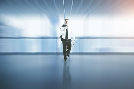 mature business man: Happy successful businessman walking in blurry interior Stock Photo