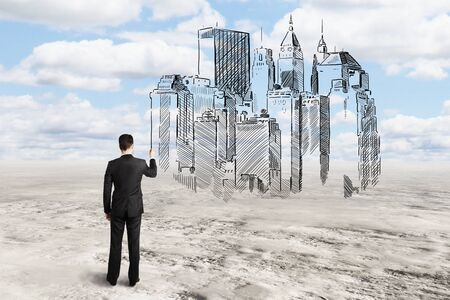 architect drawing: Young architect drawing abstract construction sketch on sky background Stock Photo