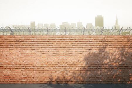 prison wall: Red brick prison wall with shadows and city view. Mock up, 3D Rendering