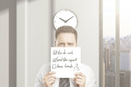 Frowny businessman cant wait for lunch break, holding paper with to-do list  in office interior with clock and city view. 3D Rendering