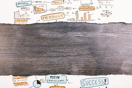 revealing: Ripped business sketch revealing dark wooden surface. Mock up