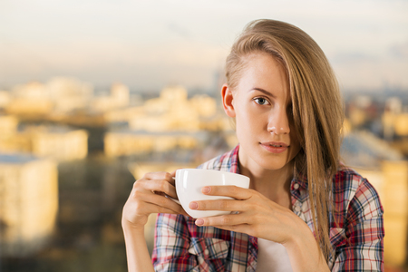 hardworking: Hardworking hipster woman drinking coffee. Portrait of woman with cup of coffee. Concept of coffee in office peoples lives Stock Photo