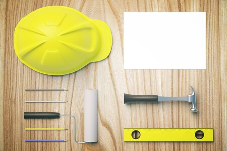 architects: Top view of wooden desktop with yellow helmet, tools and blank paper sheet. Mock up, 3D Rendering Stock Photo