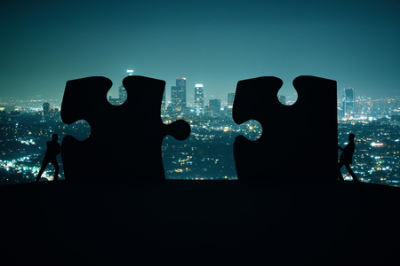 puzzle background: Partnership concept with businesspeople silhouettes putting puzzle pieces together on night city background