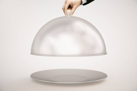 cloche: Mans hand opening silver cloche on light background. Mock up, 3D Rendering Stock Photo