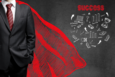 up arrow: businessman in a red raincoat and drawing success concept on wall