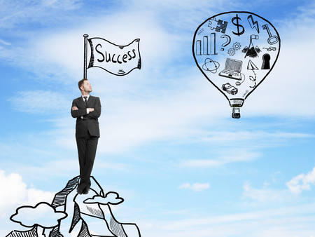 business symbol: businessman looking on balloon with drawing  business symbol. success concept