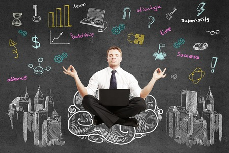 cloud computer: businessman sitting on drawing cloud with laptop and  meditating Stock Photo