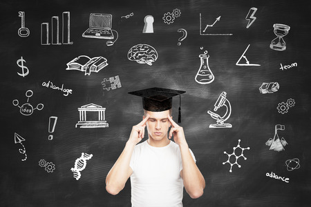 Graduation concept with education related sketches around pensive man in cap on chalkboard background