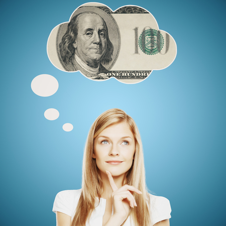 about: Pretty young woman thinking about money on bright blue background Stock Photo