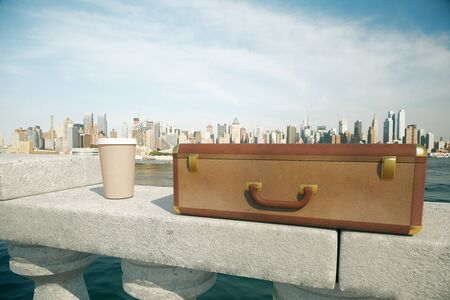 away: Clouseup of closed suitcase and coffee cup on concrete bridge railing with bright city in the background. 3D Rendering Stock Photo