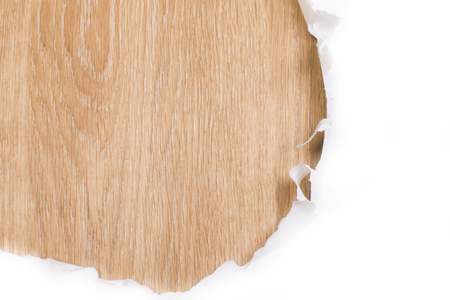 revealing: Ripped paper revealing wooden surface. Mock up Stock Photo
