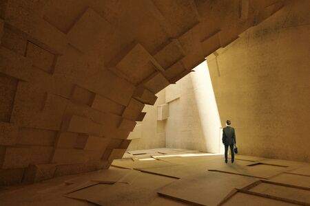 natural arch: Thoughtful businessman in abstract patterned cave-like interior with arch and sunlight. 3D Rendering