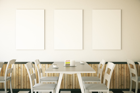 dessert: Cafe interior with cake on table and three blank posters on light wall. Mock up, 3D Rendering Stock Photo