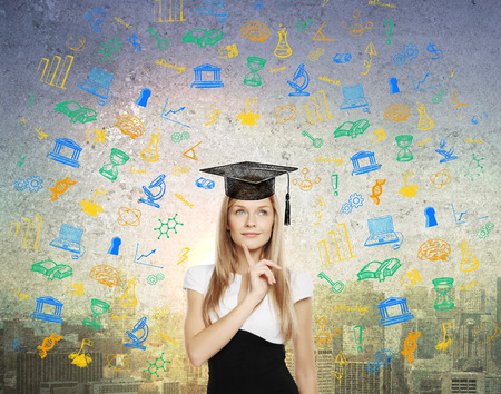university students: Graducation concept with thoughtful businesswoman in mortar board cap on abstract city background with educational sketches Stock Photo