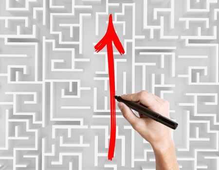 business obstacle: Business obstacle overcoming concept with hand drawing red arrow on complicated maze. Top view, 3D Rendering Stock Photo