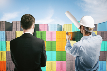 explaining: Dock worker pointing at colorful cargo containers and explaining something to businessman. 3D Rendering