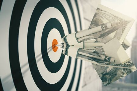 targeting: Closeup of dartboard with dollar banknote darts. Concept of targeting. 3D Rendering