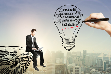 financial cliff: Business idea concept with businessman using laptop on drawn cliff and hand sketching abstract light bulb with text on city background with sunlight Stock Photo