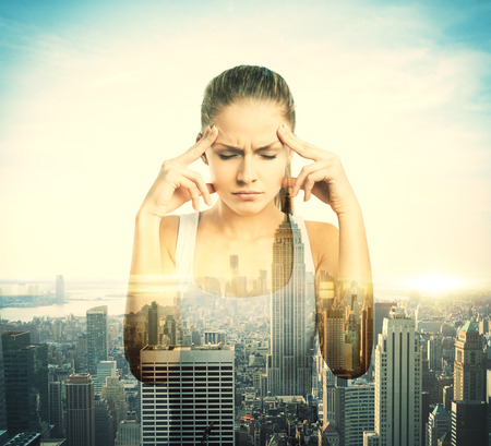 tank: Pensive young girl on city background with sunlight. Double exposure Stock Photo