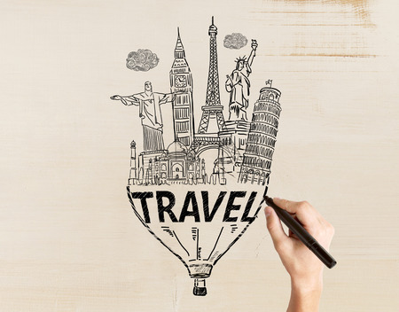 sights: Travel concept with male hand drawing sketch on light textured background Stock Photo