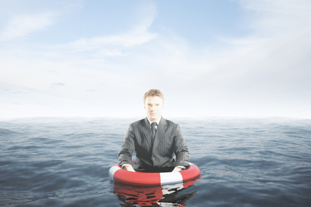 floating: Businessman with lifebuoy ring in water waist-deep. Assurance concept. 3D Rendering Stock Photo
