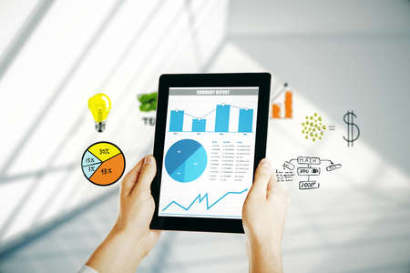 Male hands using tablet with business charts and diagrams on blurry interior background. 3D Rendering