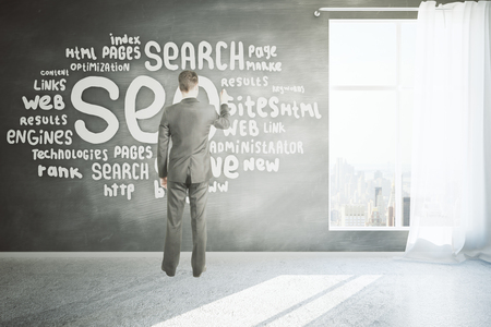 engine room: Search engine optimization concept with businessman writing on chalkboard wall in room with concrete floor, window with curtain and city view. 3D Rendering