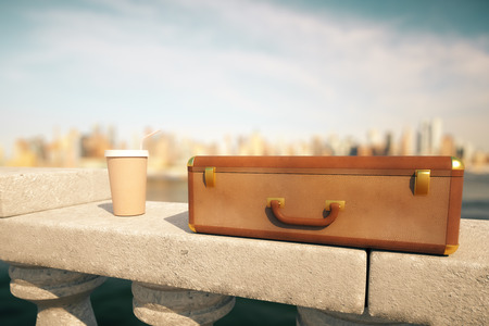 away travel: Clouseup of closed suitcase and coffee cup with straw on concrete bridge railing with bright blurry city in the background. 3D Rendering Stock Photo