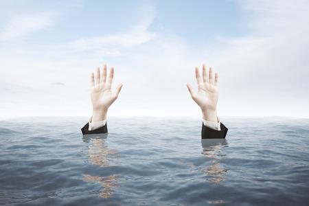 hand water: Businessman hands in water seeking rescue on sky background