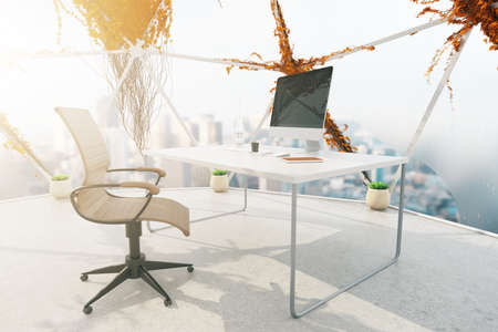 penthouse: Creative office interior with plants growning on panoramic windows, concrete floor and workspace with computer monitor and stationery items. 3D Rendering Stock Photo