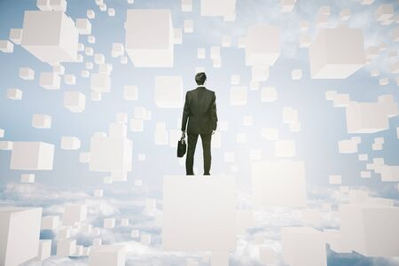 man looking at sky: Businessman with briefcase on abstract white cubes in the sky looking into the distance. Research concept. 3D Rendering Stock Photo