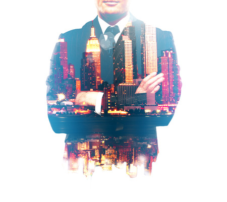 business finance: Businessman with crossed arms and night city isolated on white background. Double exposure Stock Photo