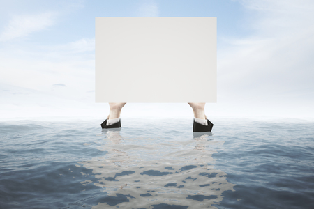 rescue: Businessman hands in water holding blank white board on sky background. Mock up Stock Photo