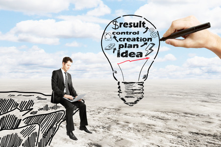 financial cliff: Business idea concept with businessman using laptop on drawn cliff and hand sketching abstract light bulb with text on landscape background